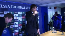 Antonio Conte raises a glass of sparkling wine