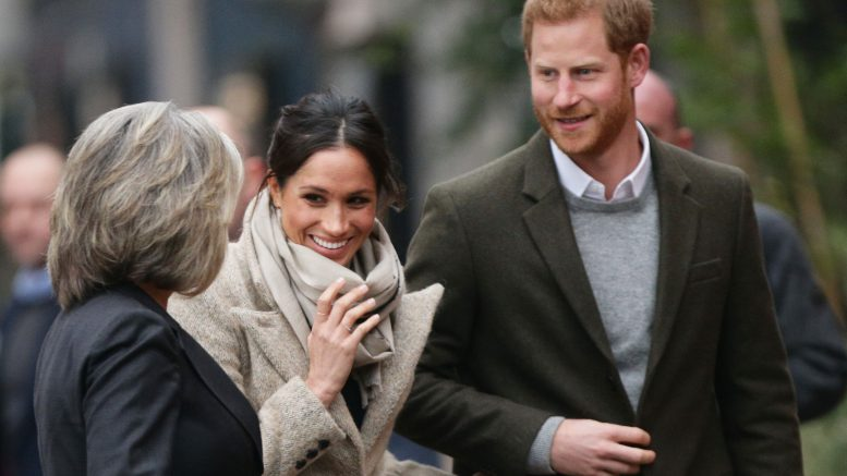Prince Harry, Meghan Markle bundled up for visit to a radio station