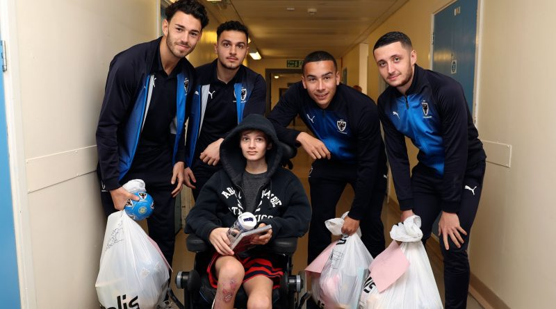 AFC Wimbledon players take gifts to kids at St George's Hospital