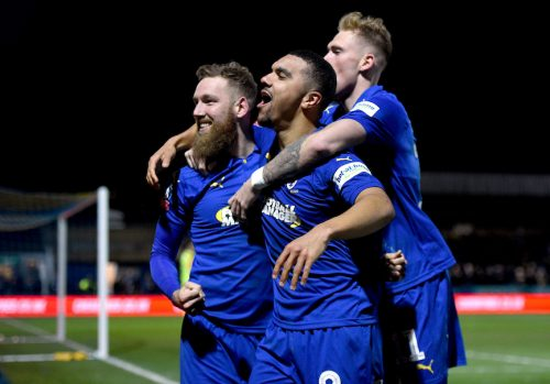 60464e72501b3 AFC Wimbledon s Scott Wagstaff celebrates scoring his side s third goal of  the game with team-mate Kwesi Appiah (centre) during the FA Cup fourth  round ...