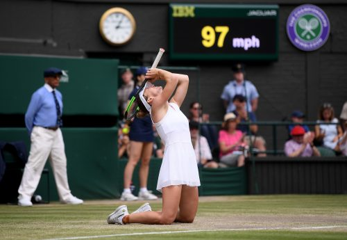 Simona Halep drops to her knees after winning Wimbledon