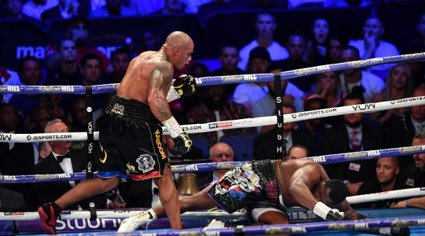 Dillian Whyte climbs off canvas to win WBC world interim title