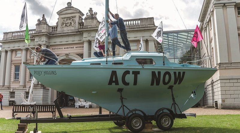Boat named the Polly Higgins made famous by climate change activist group Extinction Rebellion is on show at the National Maritime Museum