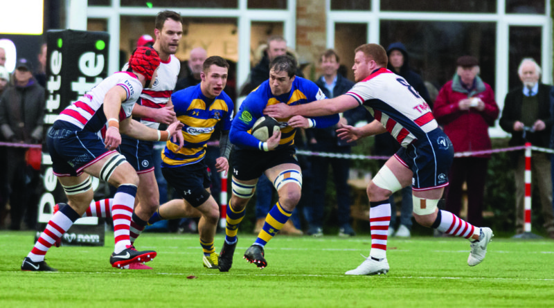 Captain Hamish Barton (dark hair running between two tacklers) who scored two of our tries on Saturday