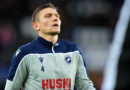 Millwall secure Shaun Hutchinson on long-term contract